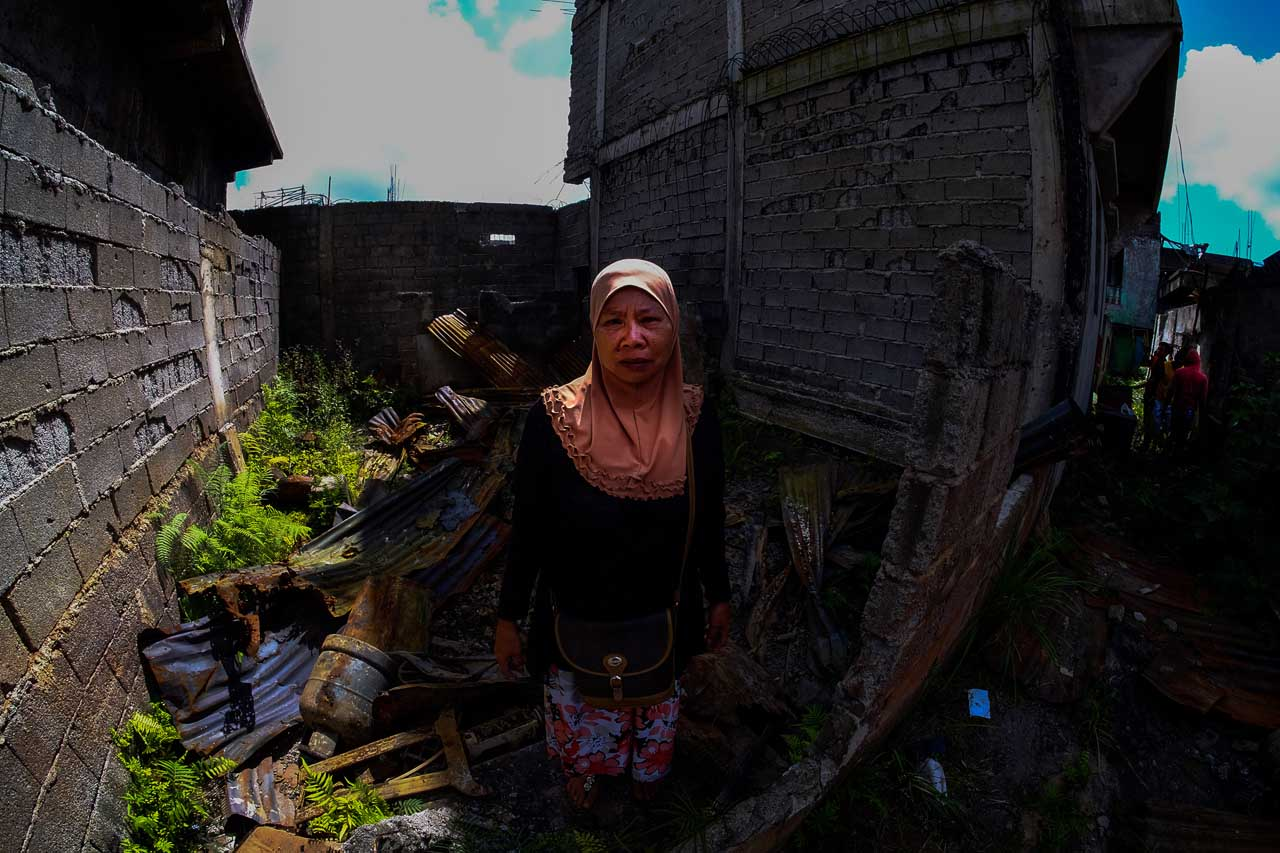 GONE. Samiara Gondarangin stands in an empty lot where her house once stood in Barangay Daguduban. Photo by Bobby Lagsa/Rappler
