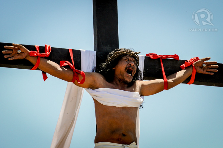 CHRIST. Enaje screams after being nailed to the cross during the Senakulo or Via Crusis.