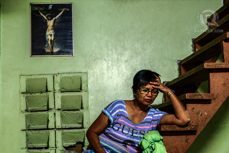 KRISTO'S WIFE. Nita Enaje rests on their house's staircase while his husband prints designs for the shirt of the volunteers.