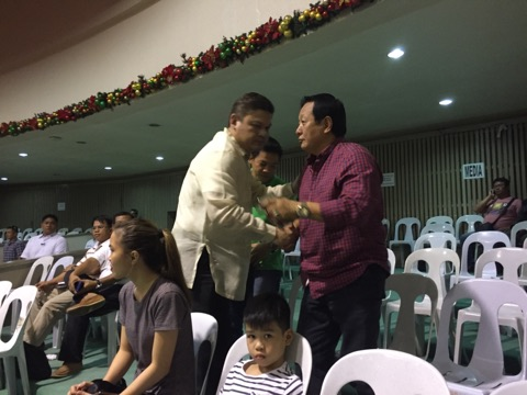 SURPRISE ANNOUNCEMENT. Presidential son Paolo Duterte, shakes hands and hugs people at the Davao City city council hall before the session, where he announces his resignation as vice mayor. Photo by Mick Basa/Rappler