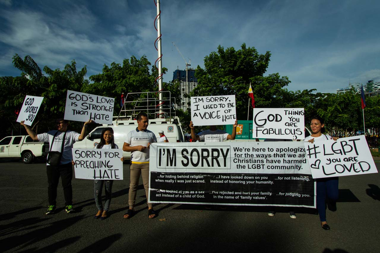YOU ARE LOVED. Participants at the 'Love Wins' gathering in Manila hold up banners to support the LGBT community. Photo by Mark Saludes