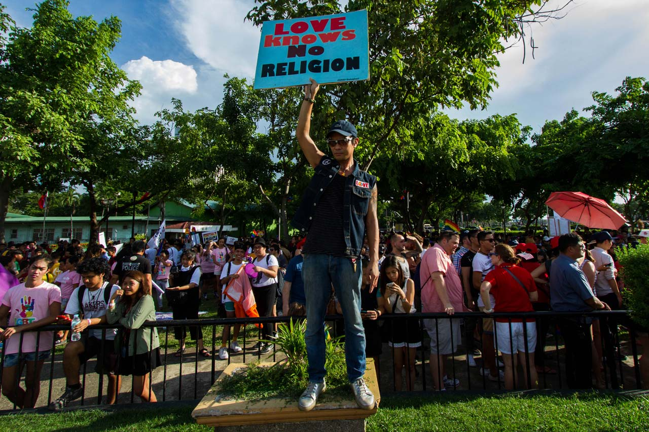 RESPECT. Members of the LGBT community rally support for the group. Photo by Mark Saludes