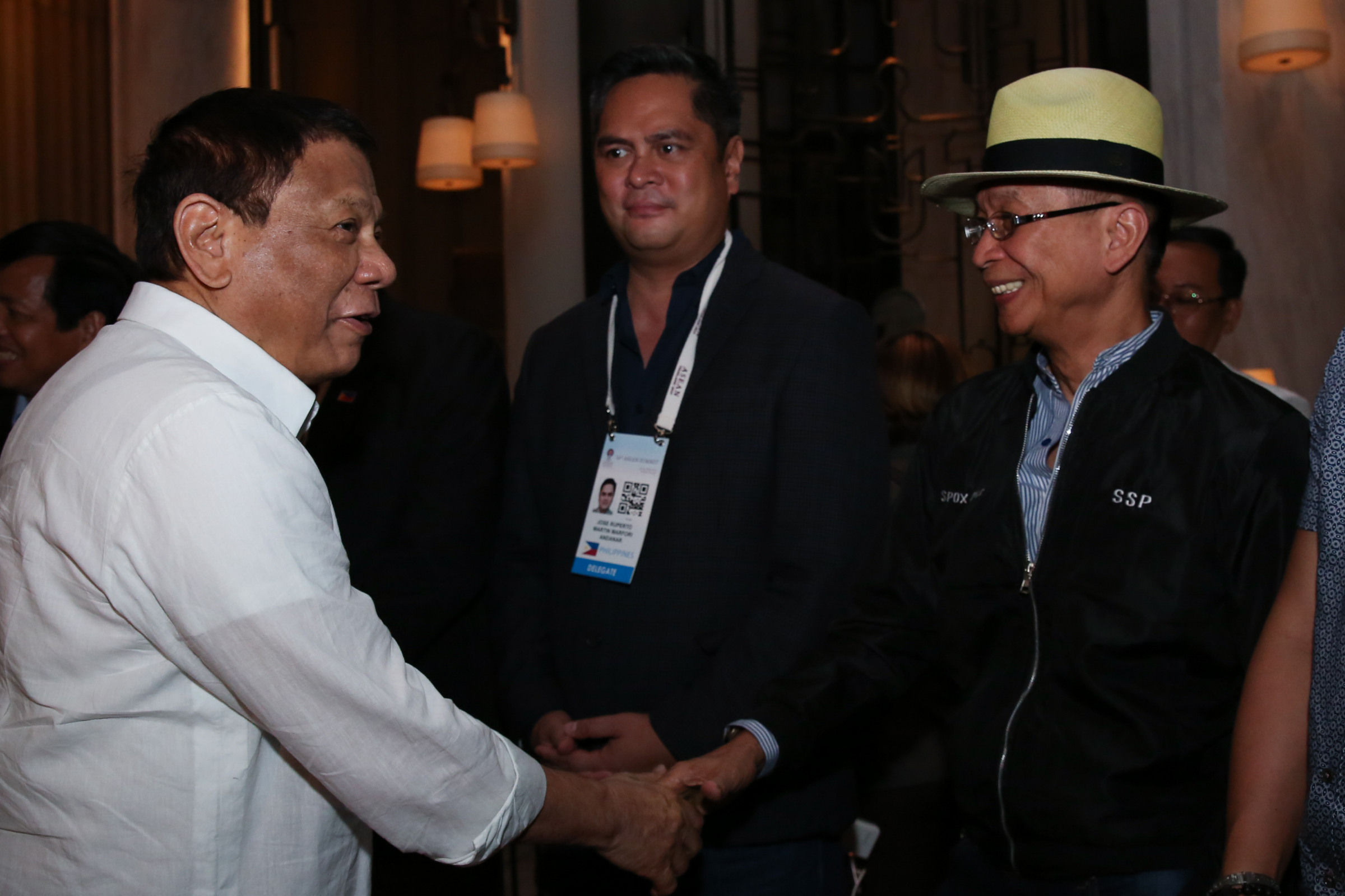 DUTERTE'S SPOKESMAN. Presidential Spokesperson Salvador Panelo (right) chats with President Rodrigo Duterte (left) and Communications Secretary Martin Andanar (center) upon the chief executive's arrival in a hotel in Bangkok, Thailand on June 21, 2019. Malacau00f1ang photo