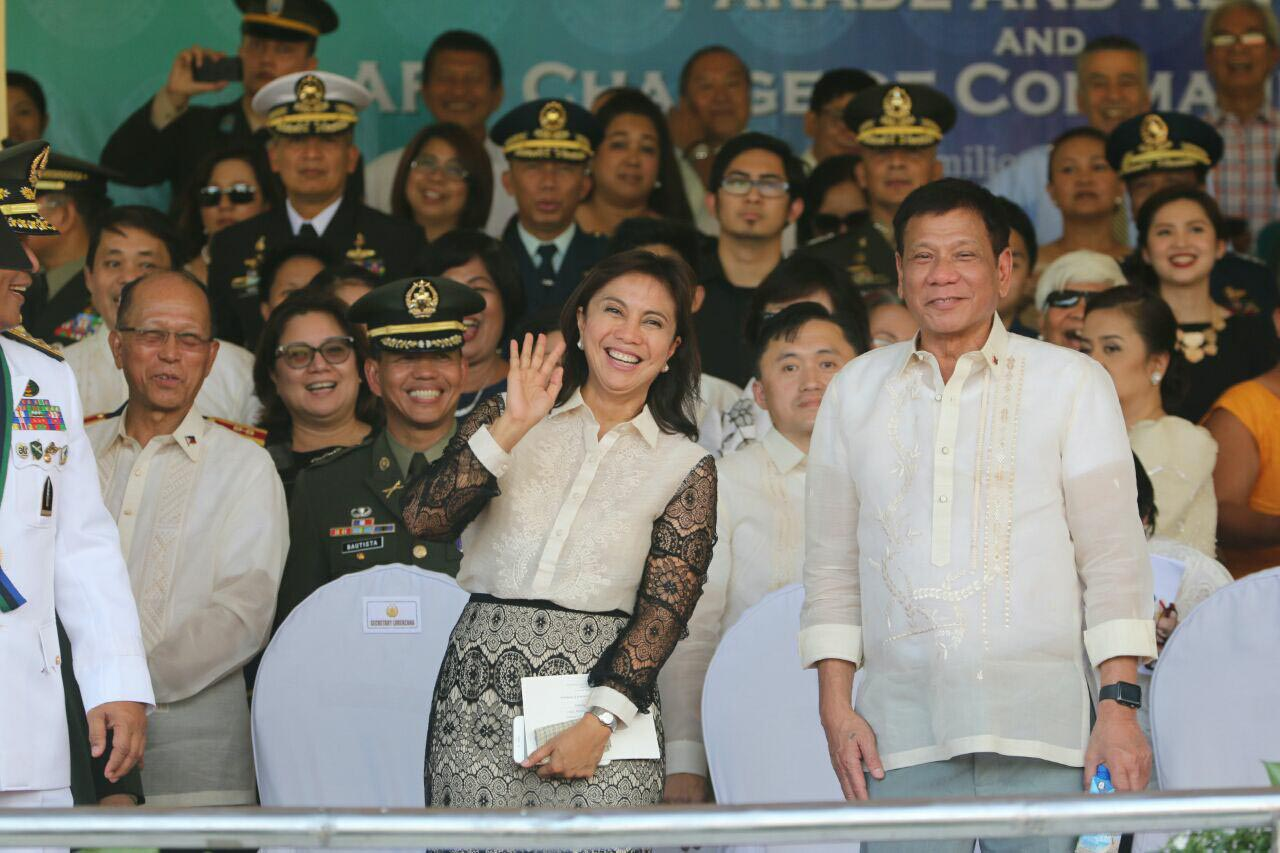 'HELLO.' Robredo waves at the camera as she stands beside Duterte. Photo courtesy of the Office of the Vice President