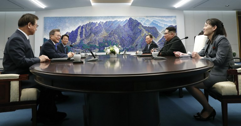SUMMIT BEGINS. South Korea's President Moon Jae-in (2nd L) attends the Inter-Korean summit with North Korea's leader Kim Jong-Un (2nd R) and his sister Kim Yo Jong (R) in the Peace House building on the southern side of the truce village of Panmunjeom on April 27, 2018. AFP PHOTO / Korea Summit Press Pool