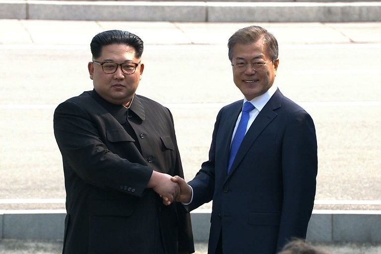 HISTORIC. This screen grab from the Korean Broadcasting System (KBS) taken on April 27, 2018 shows North Korea's leader Kim Jong-Un (L) and South Korea's President Moon Jae-in shaking hands at the Military Demarcation Line that divides their countries at Panmunjeom. File photo by Korean Broadcasting System/AFP