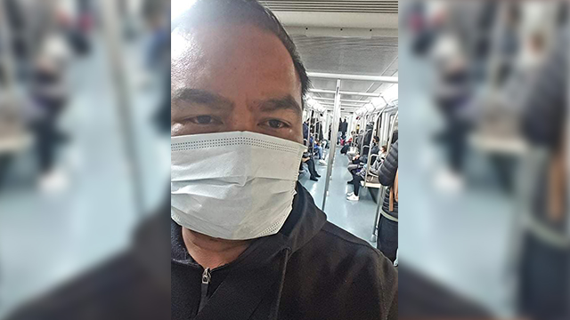 IN TRANSIT. Rhoderick Ople wears a face mask while riding a train in Italy. Photo courtesy of Rhoderick Ople