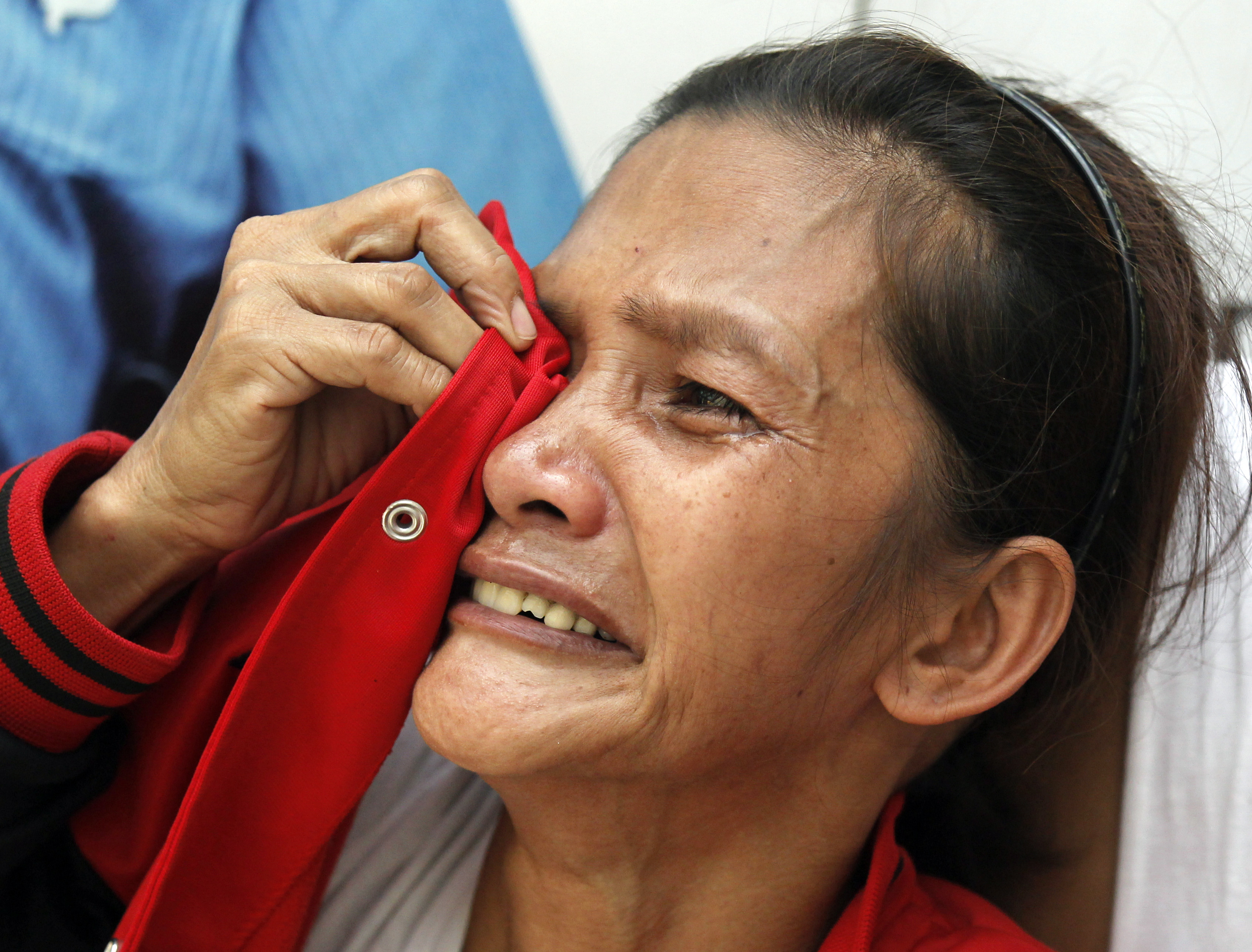 BENEFITS FOR FAMILIES. A Filipino relative of a missing factory worker reacts following a fire at a warehouse in Valenzuela City. The government promises to provide benefits to families of victims. EPA/FRANCIS R. MALASIG