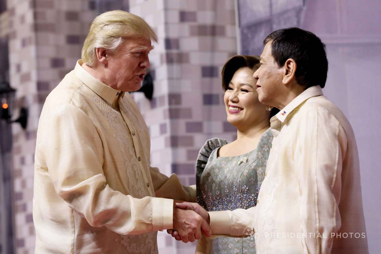 PRESIDENTIAL HANDSHAKE. US President Donald Trump shakes hands with President Rodrigo Duterte and partner Honeylet Avanceu00f1a at the ASEAN Summit gala dinner in November. Malacau00f1ang photo