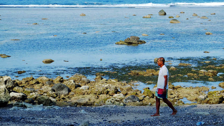 SHAMAN. Uncle Ernie surveying the shores of Diura for the kapayvanuvanua. Photo by Potpot Pinili/Rappler