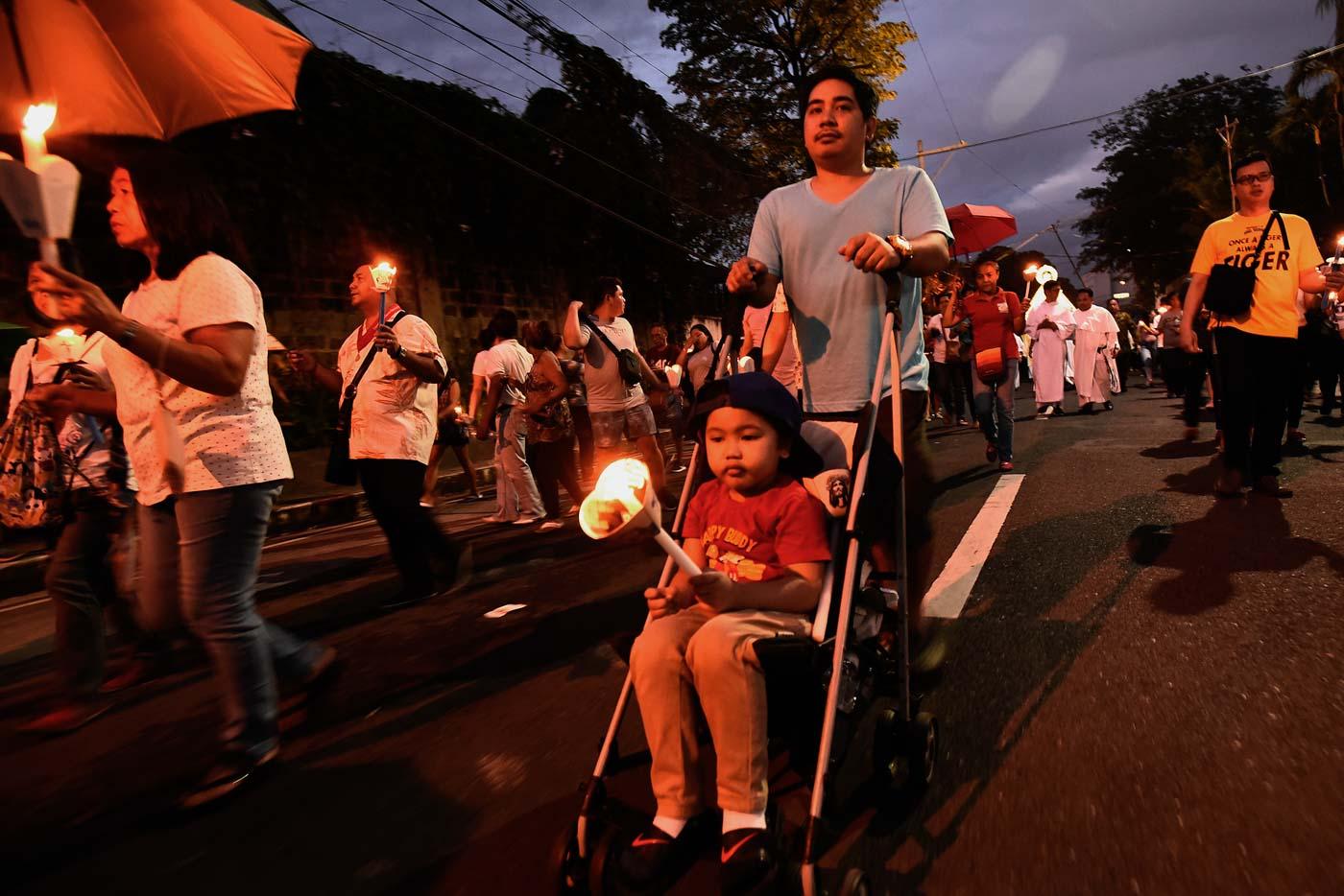 SACRIFICE. The La Naval grand procession is held around Santo Domingo Church in Quezon City. Photo by Maria Tan/Rappler