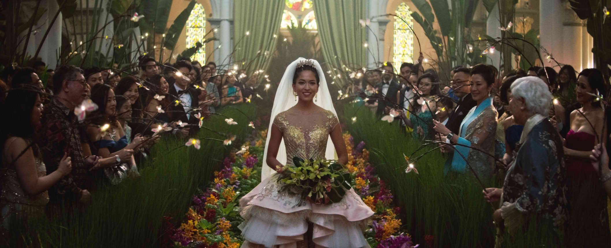 WEDDING OF THE YEAR. Araminta Lee walks down the aisle of the chapel at CHIJMES, now called CHIJMES Hall, a function space that was elaborately decorated for the movie. Photo courtesy of Warner Bros Pictures