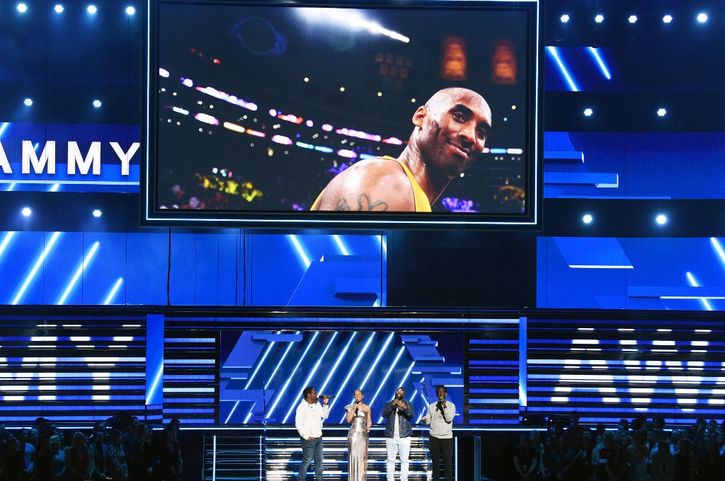KOBE. An image of the late Kobe Bryant is projected onto a screen while host Alicia Keys speaks onstage during the 62nd Annual GRAMMY Awards at STAPLES Center on January 26, 2020 in Los Angeles, California. Photo by Kevin Winter/Getty Images for The Recording Academy /AFP