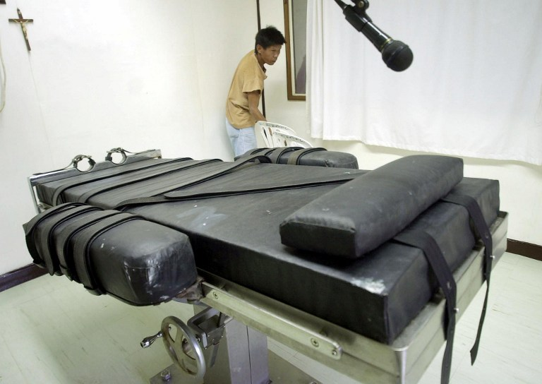 LETHAL INJECTION CHAMBER. An inmate prepares the lethal injection chamber at the New Bilibid Prison in Muntinlupa on January 9, 2004, two years before former President Gloria Macapagal-Arroyo abolished the capital punishment in the country. File photo by Joel Nito/AFP