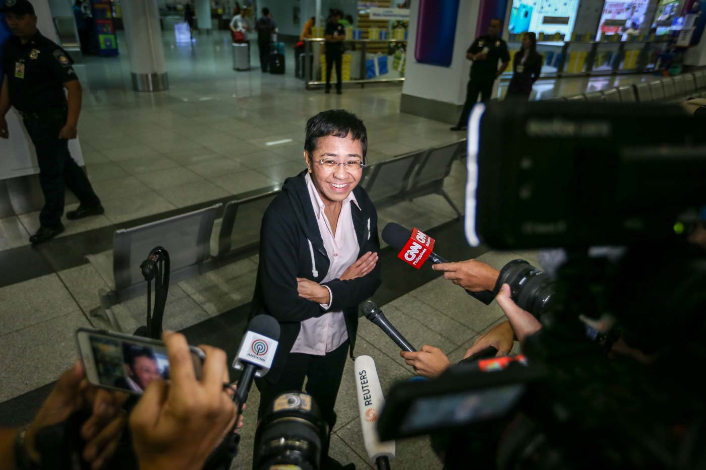 CASES. Rappler CEO Maria Ressa arrives at the NAIA Terminal 3 on December 2, 2018, a day before posting bail at the Pasig City Regional Trial Court for one of 5 tax cases filed by the Department of Justice. Photo by LeAnne Jazul/Rappler