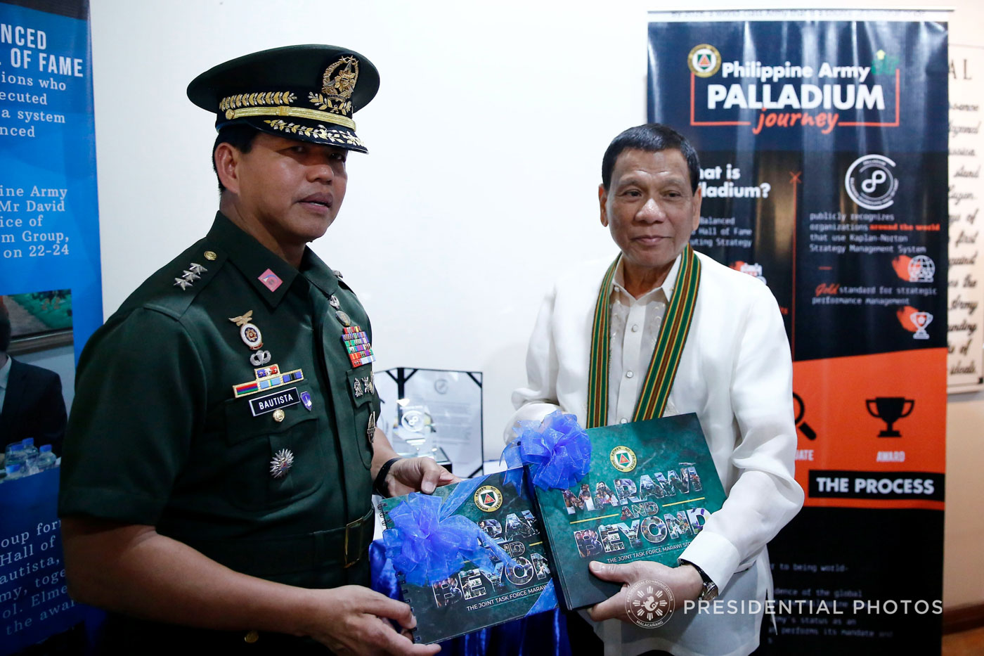 MARAWI AND BEYOND. President Rodrigo Duterte receives a copy of the book 'Marawi and Beyond' from Army chief Lieutenant General Rolando Bautista.