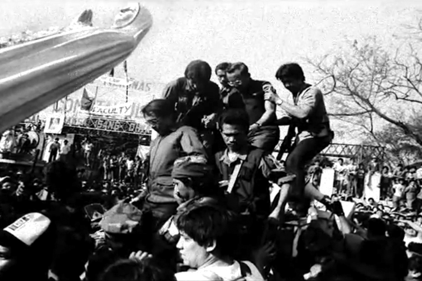 REVOLUTION LEADERS. Fidel Ramos (middle, wearing glasses) being assisted by some  RAM soldiers led by Honasan (left of Ramos) during the EDSA People Power on February 22, 1986. Photo by Romeo Mariano