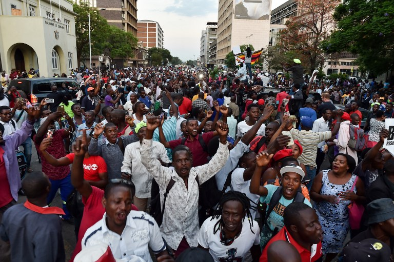 STREET PARTY. People celebrate in the streets of Harare, after the resignation of Zimbabwe's president Robert Mugabe on November 21, 2017.  Tony Karumba/AFP