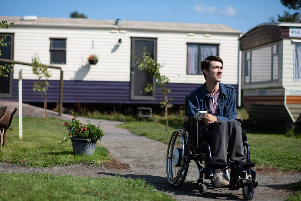 NEW KID ON THE BLOCK. George Robinson is introduced as Isaac, Maeve's new trailer park neighbor. Photo courtesy of Netflix
