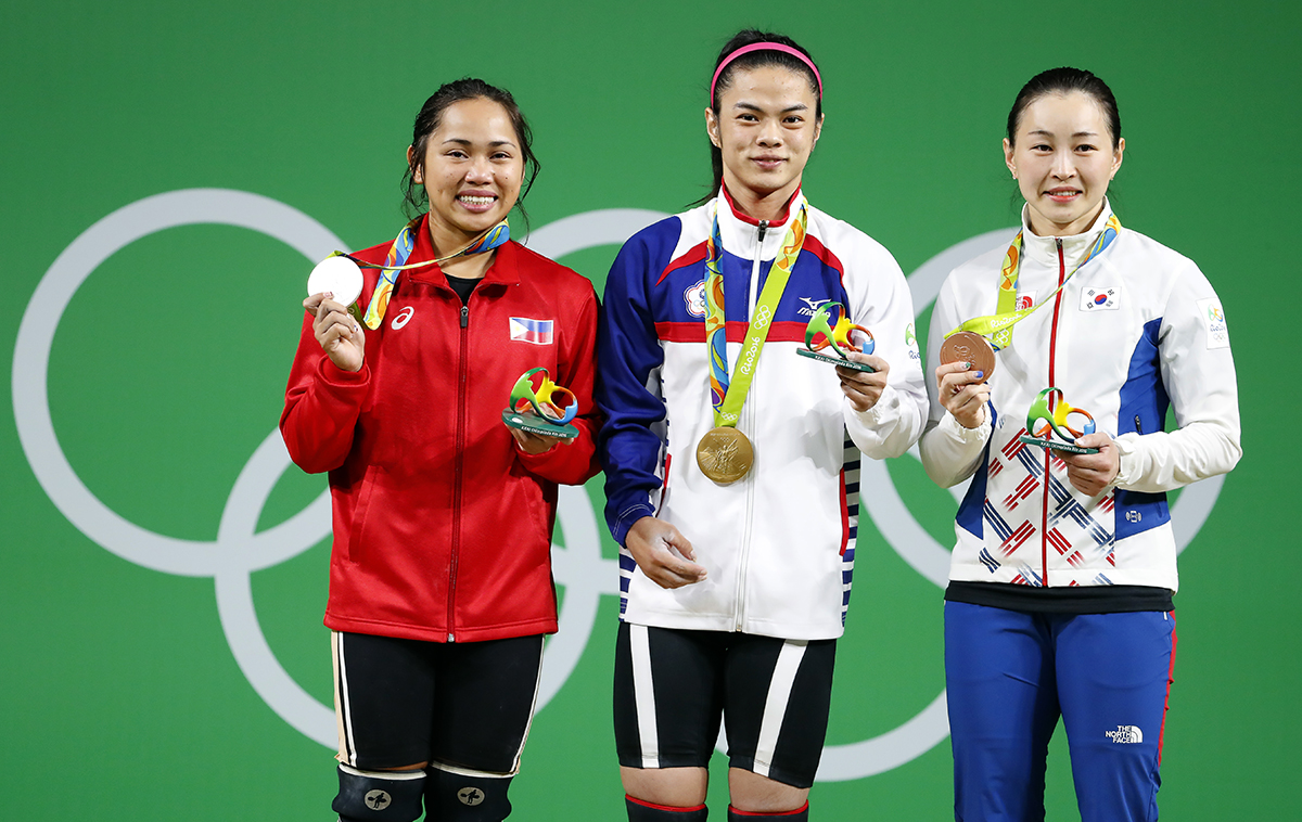HISTORY. Hidilyn Diaz (L) stands with fellow medalists Hsu Shu-ching (C) of Taiwan, with her gold medal, and Yoon Jin-hee (R) of South Korea, with the bronze. EPA/NIC BOTHMA