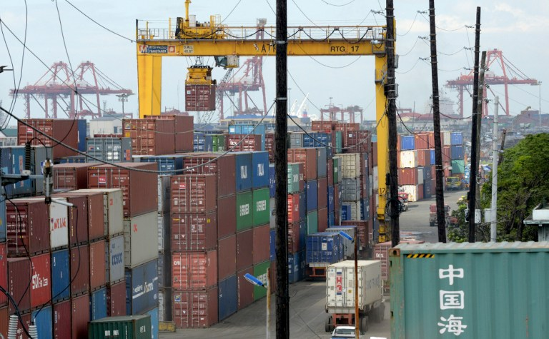 TAXES. Certain shipments are exempt from the value-added tax on imported goods. File photo by Jay Directo/AFP