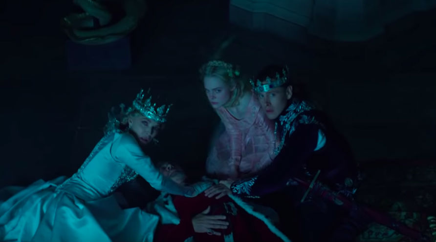 PROTECTION. Aurora and her family protect her father after an argument with Maleficent.