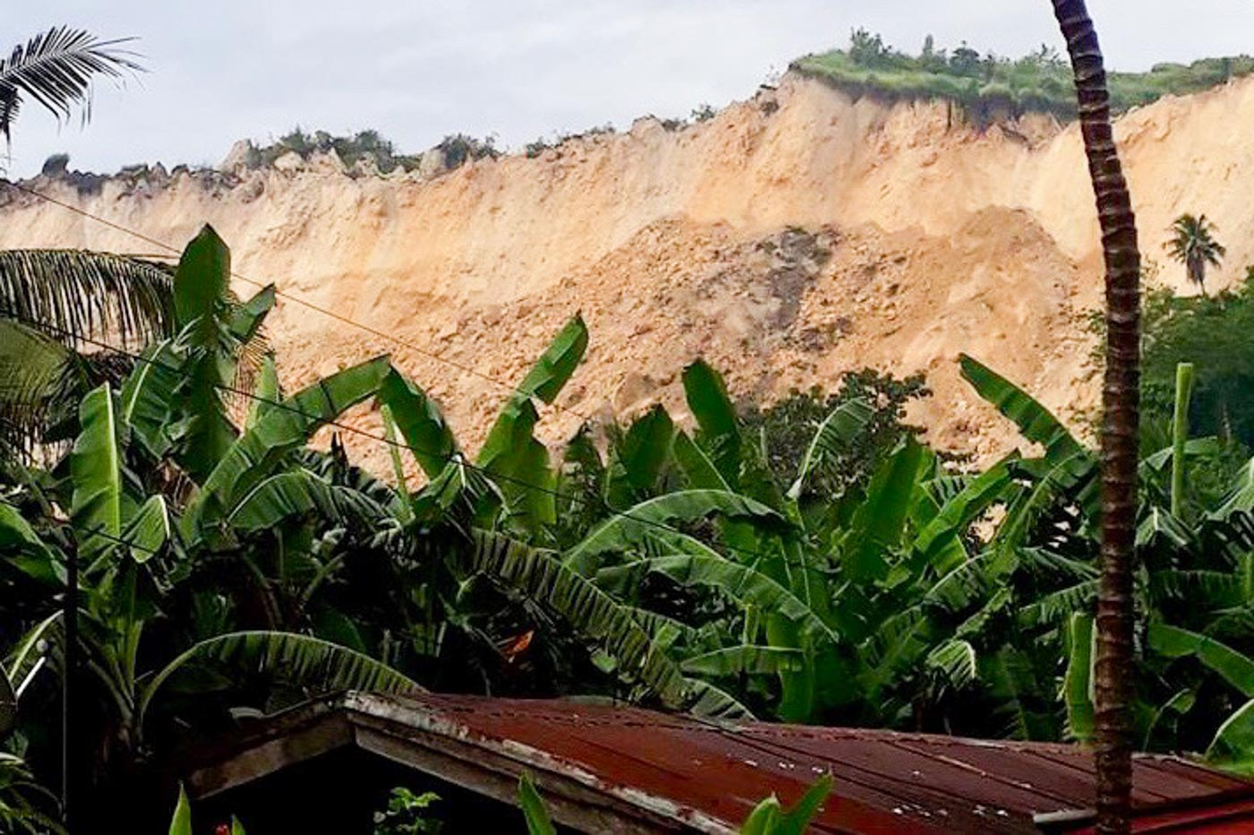 DISASTER. A landslide hits a village in Naga City, Cebu. Initial reports say the landslide buried dozens of homes and killed at least 3 people. Photo by John Rhay Echavez