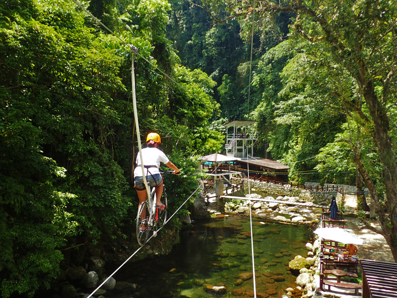ZIPBIKING. This is similar to and is exciting like ziplining, except that you ride on a bike. Photo taken at Panicuason Hot Springs, Naga City
