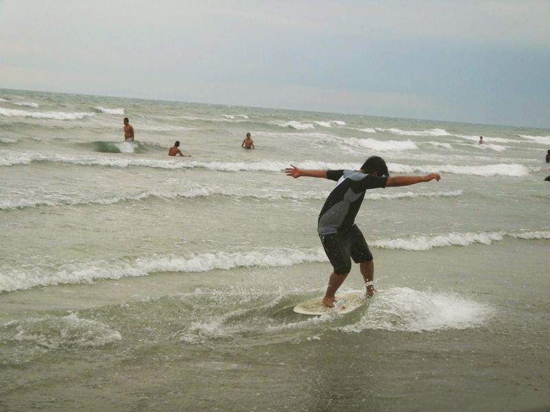 SKIMBOARDING. A fun activity that lets you ride breaking waves near the shore