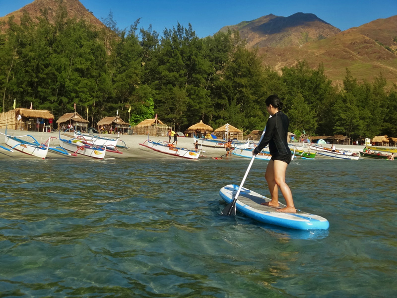 STAND-UP PADDLEBOARDING. Though this may look deceptively easier than surfing, it requires balance and coordination, too