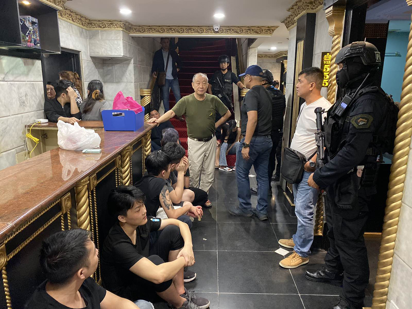 RAIDED: A photo provided by Makati police shows some of the POGO workers arreste during the raid.
