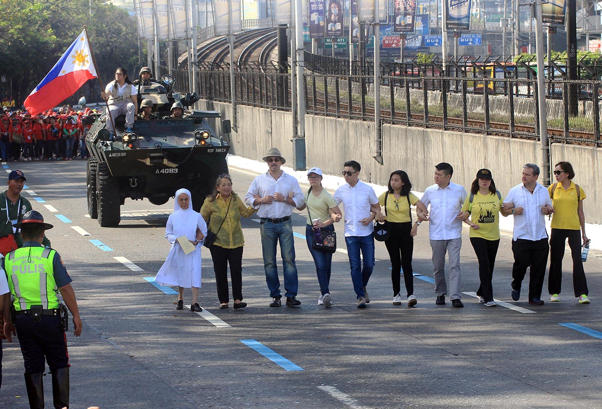 REMEMBERING EDSA. The historic 'Salubungan' between the civilian, church people and the military and police during the 32nd anniversary of the EDSA People Power Revolution at the People Power Monument in Edsa Quezon City on Sunday, February 25, 2018. The revolt toppled Ferdinand Marcos from power in 1986. Photo by DARREN LANGIT