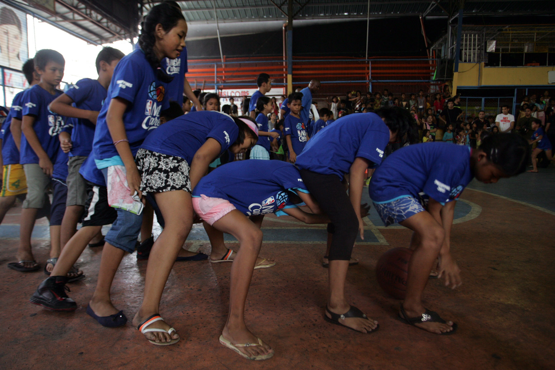 Kids participate in drills that encourage them to work together. Photo by Josh Albelda/Rappler
