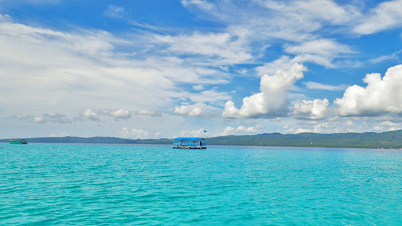 CLEAR BLUES. The islandu2019s surrounding clear waters change into different shades of mesmerizing blues.