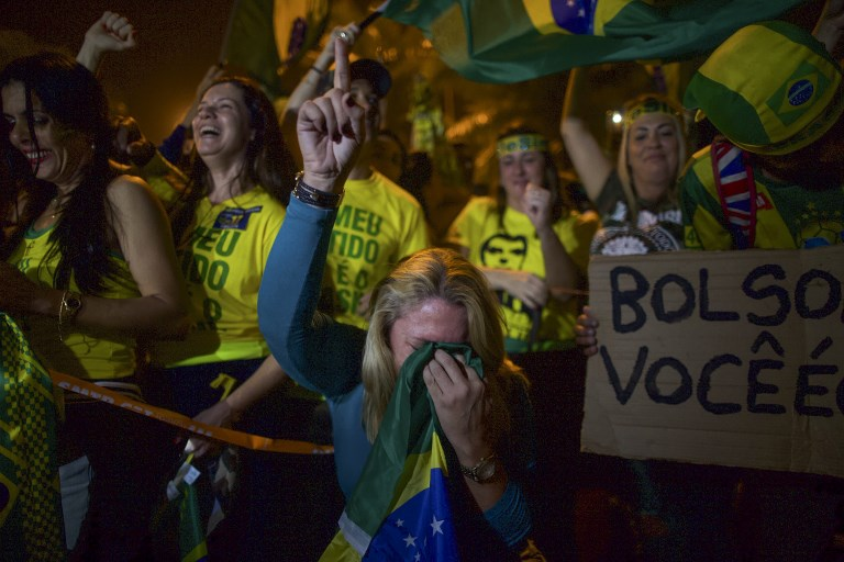 BOLSONARO WINS. Supporters of far-right lawmaker and presidential candidate for the Social Liberal Party (PSL), Jair Bolsonaro, celebrate the election in Rio de Janeiro, Brazil, on October 28, 2018. Photo by Mauro Pimentel/AFP