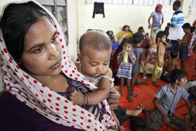 MOTHER AND CHILD. A mother and her baby inside the refugee camp at Kuala Langsa. Photo by EPA