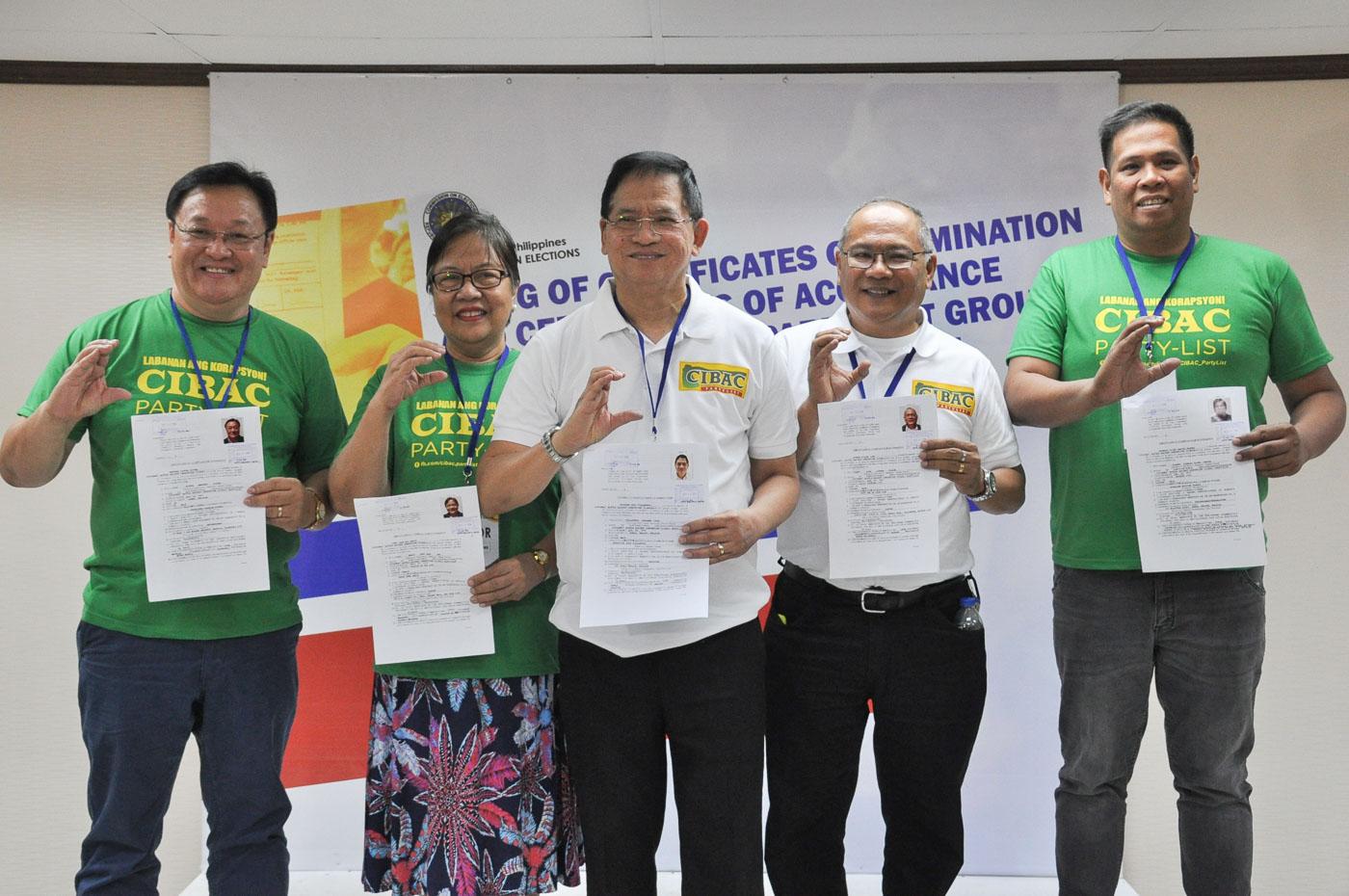 Evangelist Eddie Villanueva accompanies members of CIBAC at Comelec. Photo by Ben Nabong/Rappler