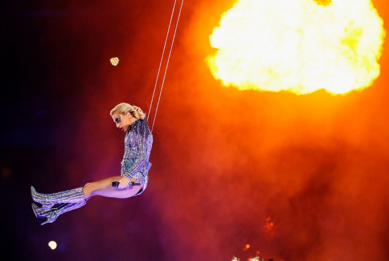 FLYING. Lady Gaga performs during the Pepsi Zero Sugar Super Bowl 51 Halftime Show at NRG Stadium on February 5, 2017 in Houston, Texas. Photo by Kevin C. Cox/Getty Images/AFP
