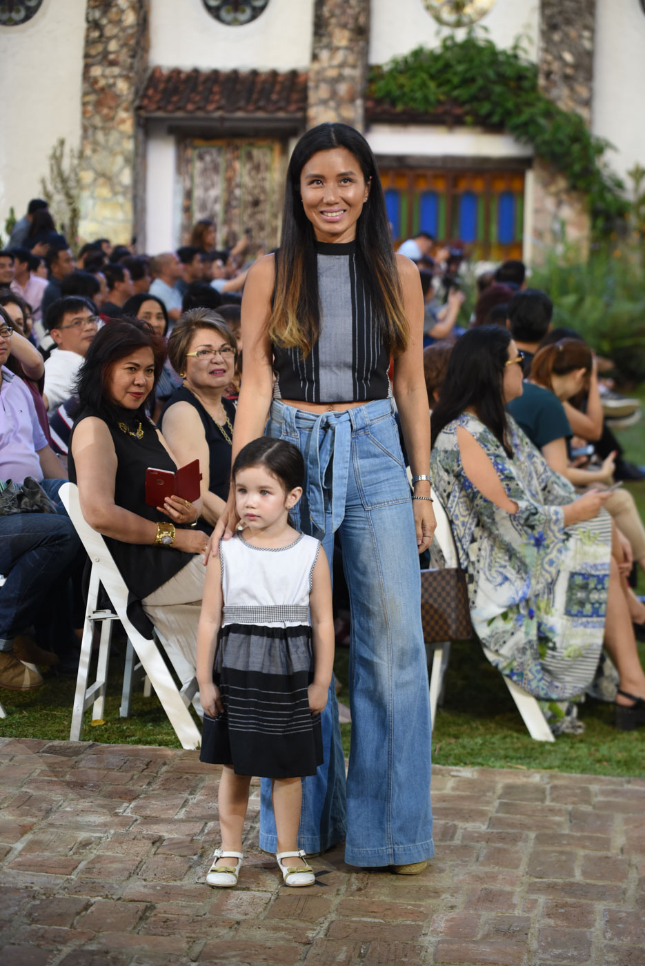 LITTLE MODEL. Artist and women's rights advocate Nikki Luna walks the runway with her daughter Alandra.