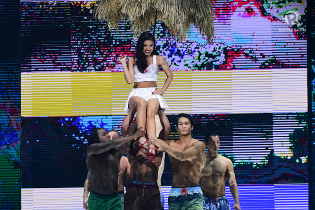 PIN-UP GIRL. Maine is carried out on stage by male models.