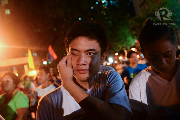 TEARS OF JOY. A rallyist in front of the Indonesian embassy in the Philippines tears up as news on Mary Jane Veloso's last-minute reprieve breaks. Photo by Jansen Romero/Rappler.com