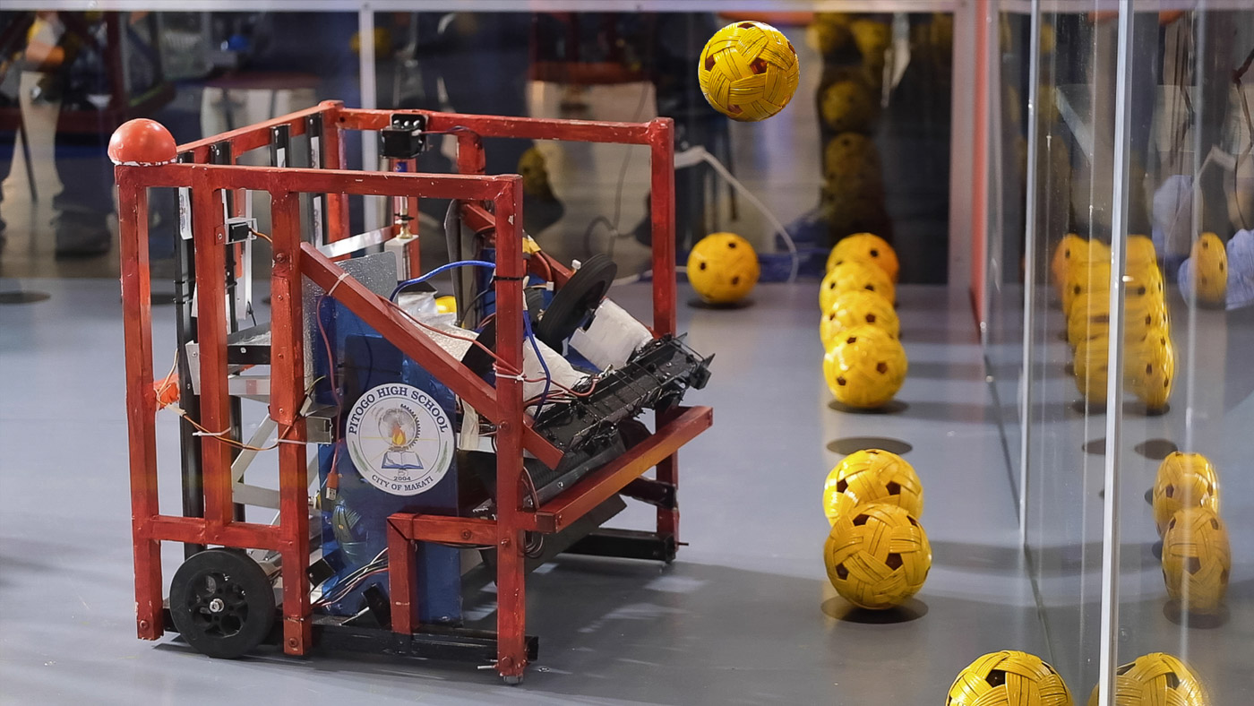 The robot of Pitogo HS attempts a shot in one of its wins making their way to being hailed as the Best Team in the 2019 Tagisang Robotics Competition. Photo courtesy of DOST-Science Education Institute