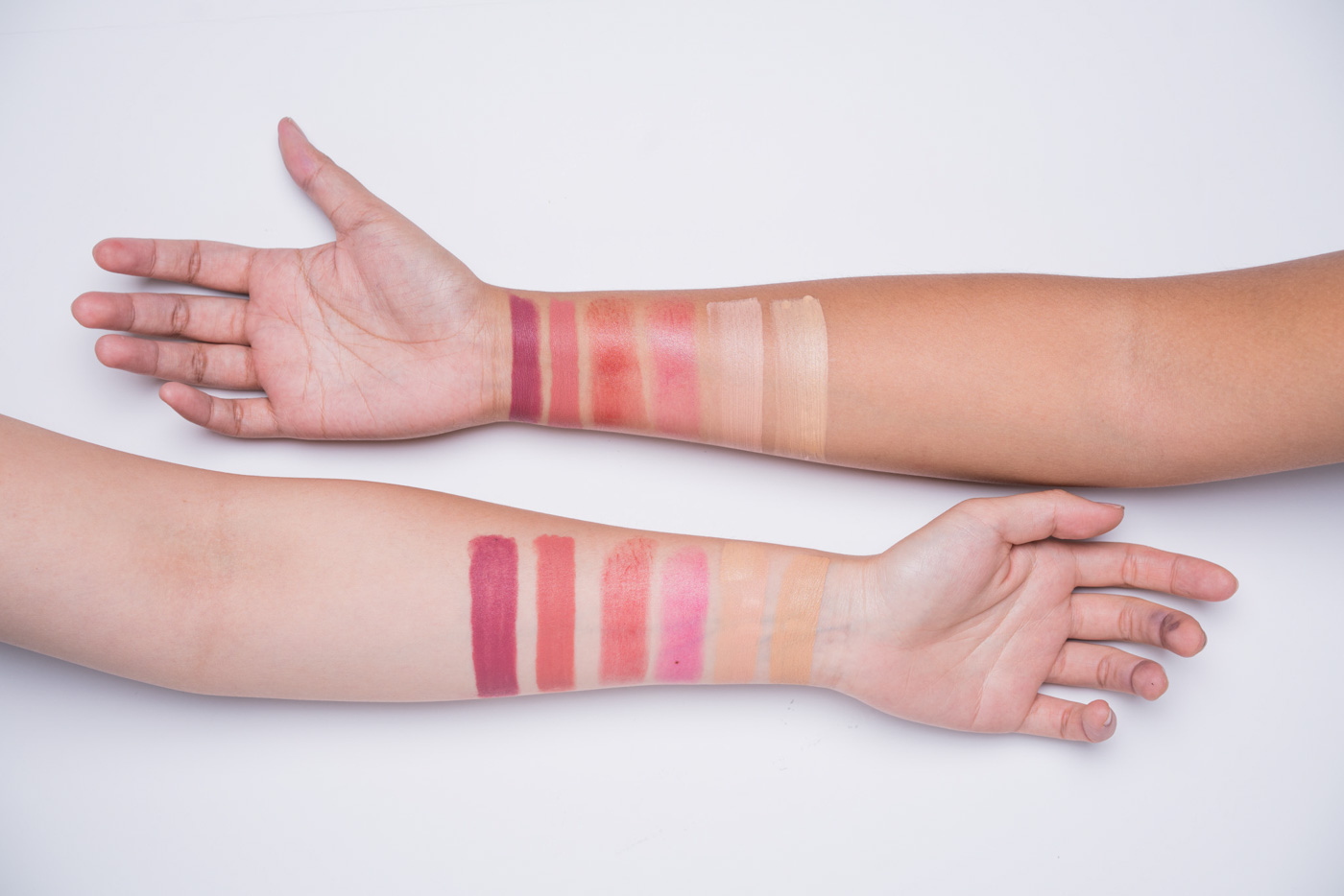 SWATCHES. Left to right: Shut Up u0026 Kiss Me Moisturizing Matte Lippie in Forever Summer; Shut Up u0026 Kiss Me Moisturizing Matte Lippie in Lost in Paradise; Pinch Me Summer-Proof Natural Lip u0026 Cheek Stick in Cherry Glow; Pinch Me Summer-Proof Natural Lip u0026 Cheek Stick in Berry Fresh; Good To Go Five Minute Fresh Face Summer-Proof Foundation u0026 Concealer in Medium; Good To Go Five Minute Fresh Face Summer-Proof Foundation u0026 Concealer in Light.