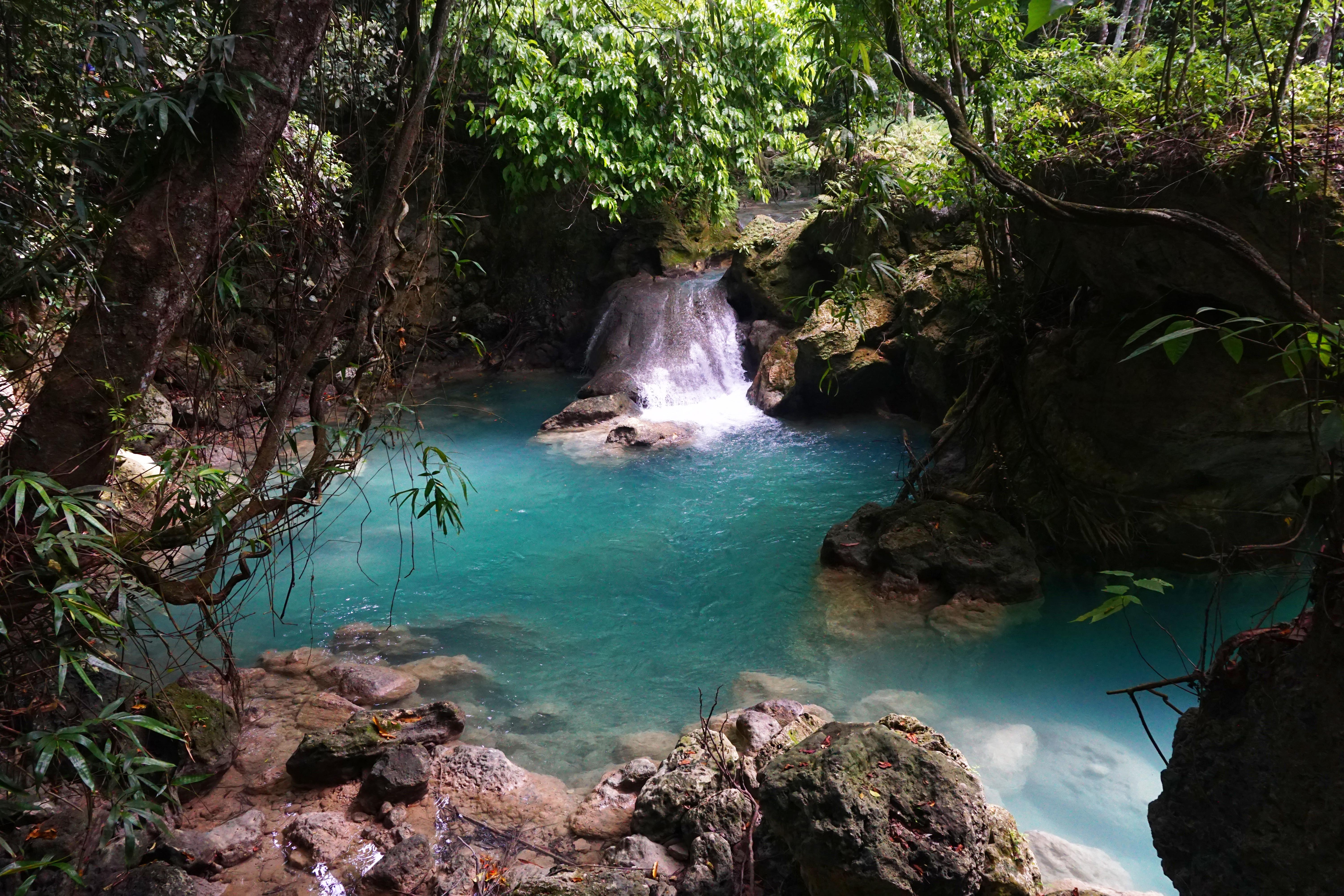 Even little streams like this one on the way to Kawasan are already picture-perfect. Photo by Louie Lapat/Rappler