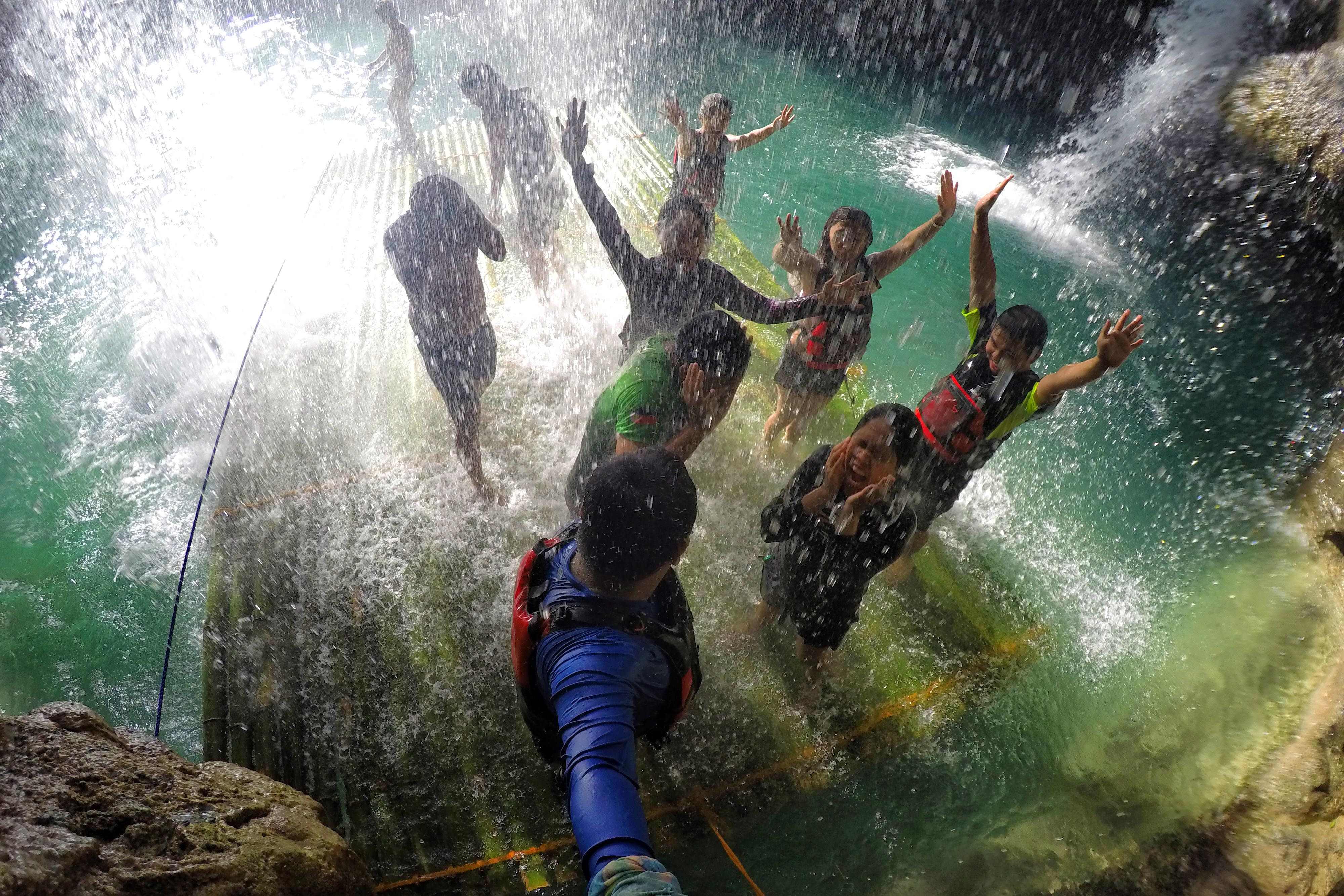 NATURE'S MASSAGE. At the second level of Kawasan, this giant shower can soothe body pains as its cascading water seems like a massage. Photo by Louie Lapat/Rappler
