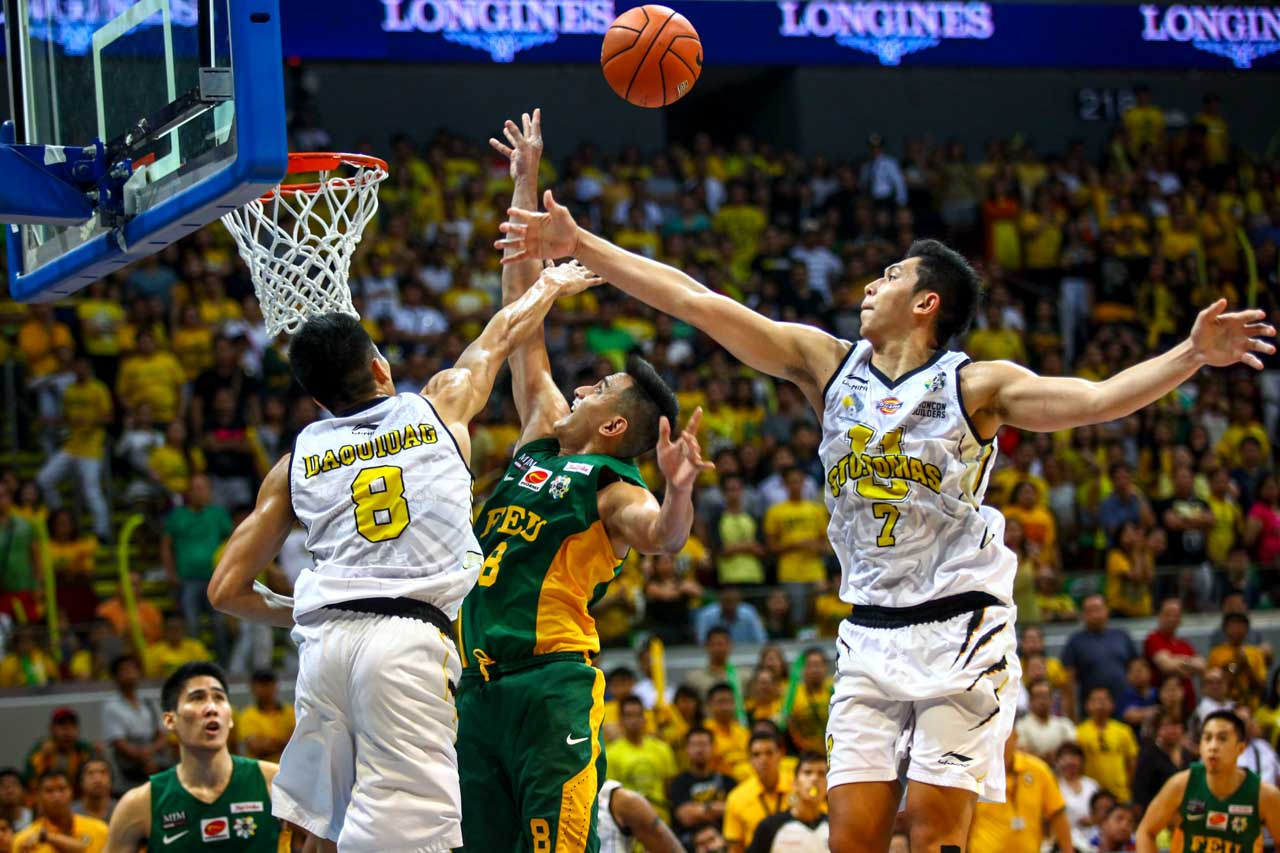 BATTLE. Kevin Ferrer (right) and Ed Daquioag (left) try to stop Russell Escoto (center). Photo by Josh Albelda/Rappler