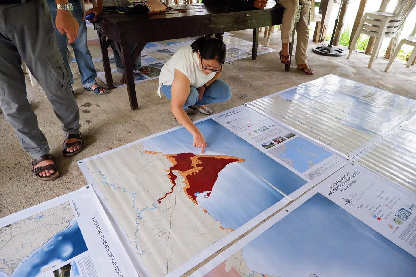 FLOOD SUSCEPTIBILITY. A participant in the National Land Observatory Workshop looks at the flood-prone area in Infanta, Quezon. Photo by PAKISAMA