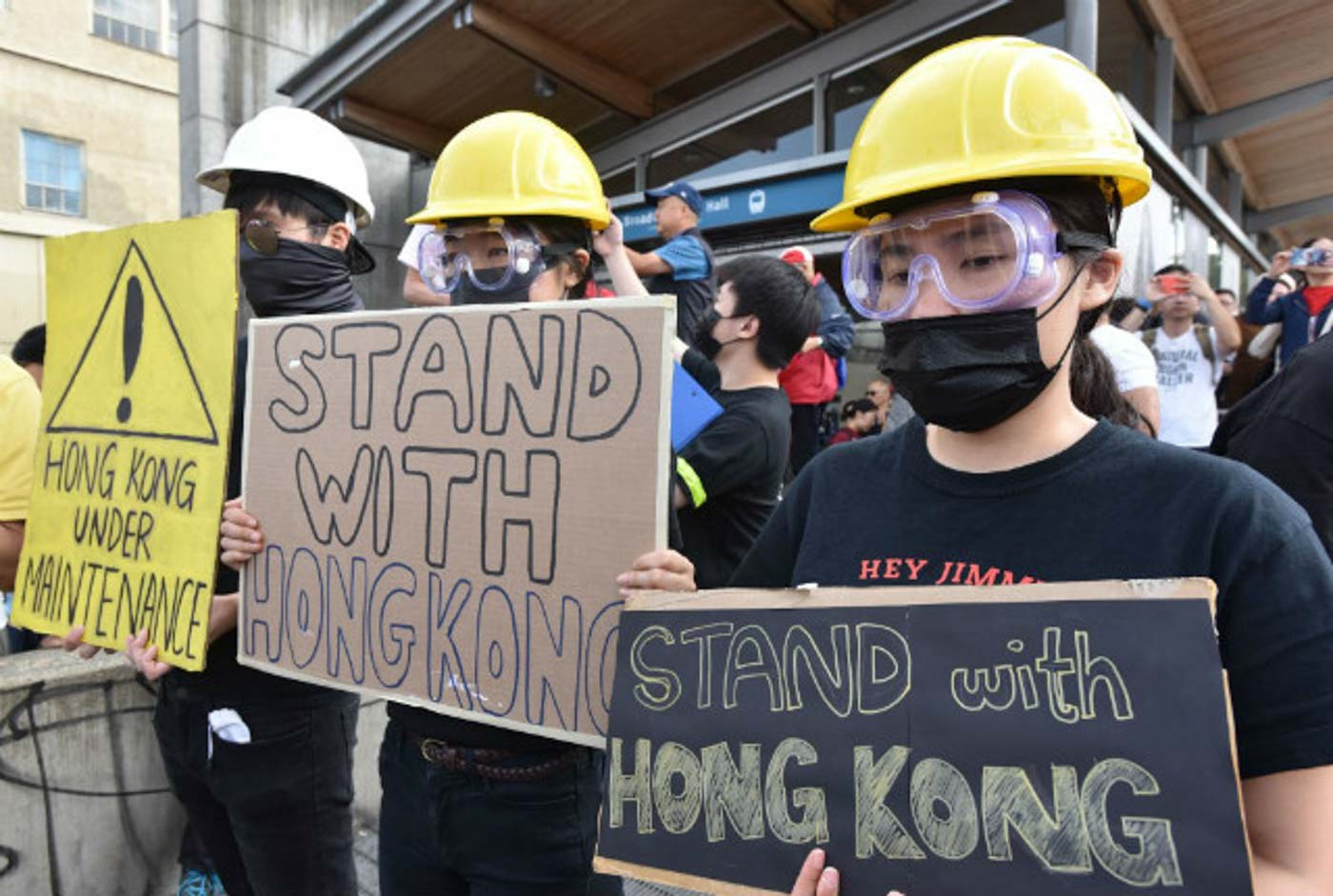 STAND WITH HONG KONG. Pro-Hong Kong supporters hold signs during a rally at the Broadway-City Hall SkyTrain Station in Vancouver, Canada on August 17, 2019. Photo by Don MacKinnon/AFP