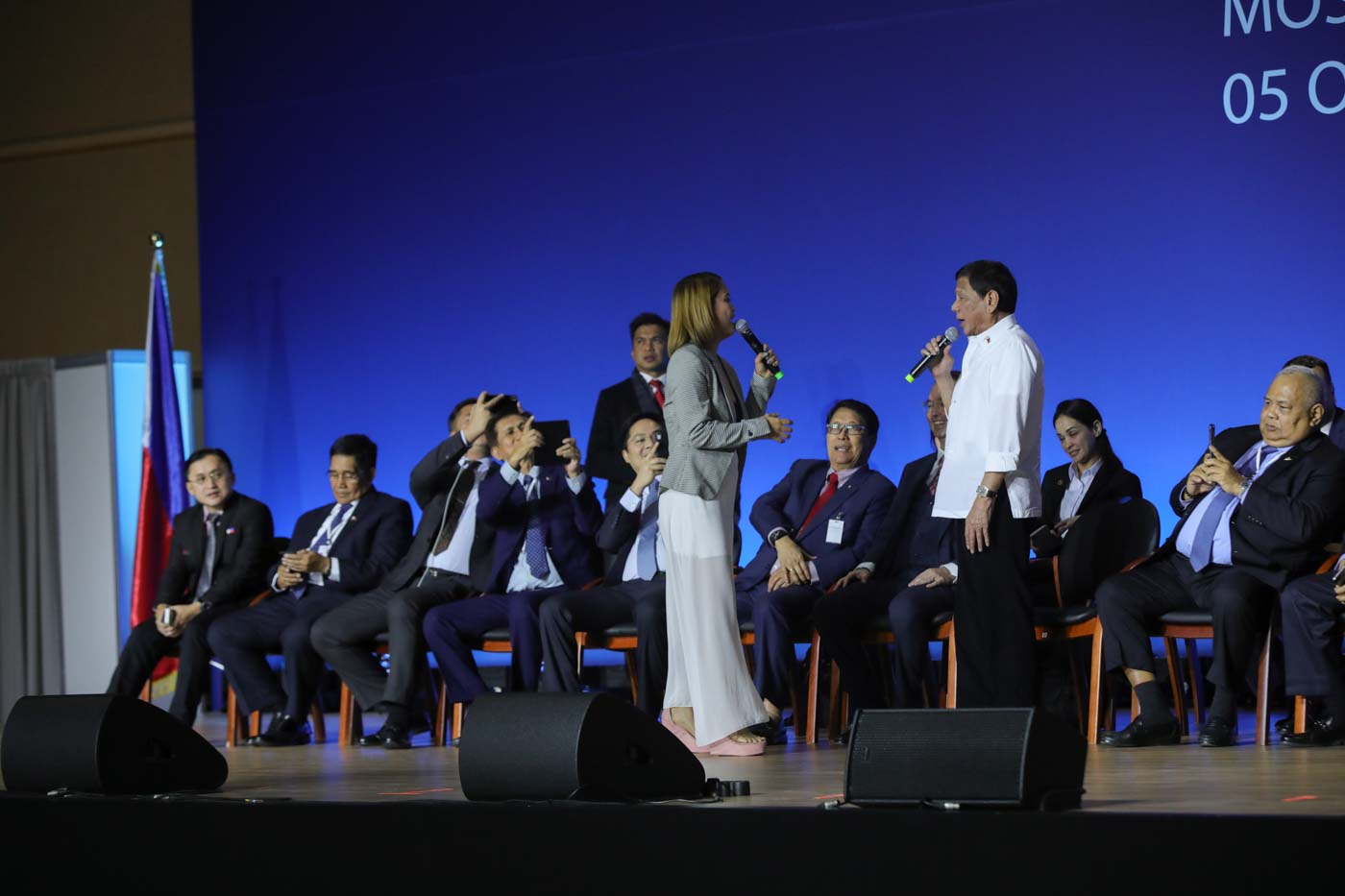 President Rodrigo Roa Duterte sings a duet with one of the performers during his meeting with the Filipino community at the Exhibition of Achievements of National Economy (VDNH) in Moscow on October 5, 2019. ROBINSON NIu00c3u0091AL JR./PRESIDENTIAL PHOTO