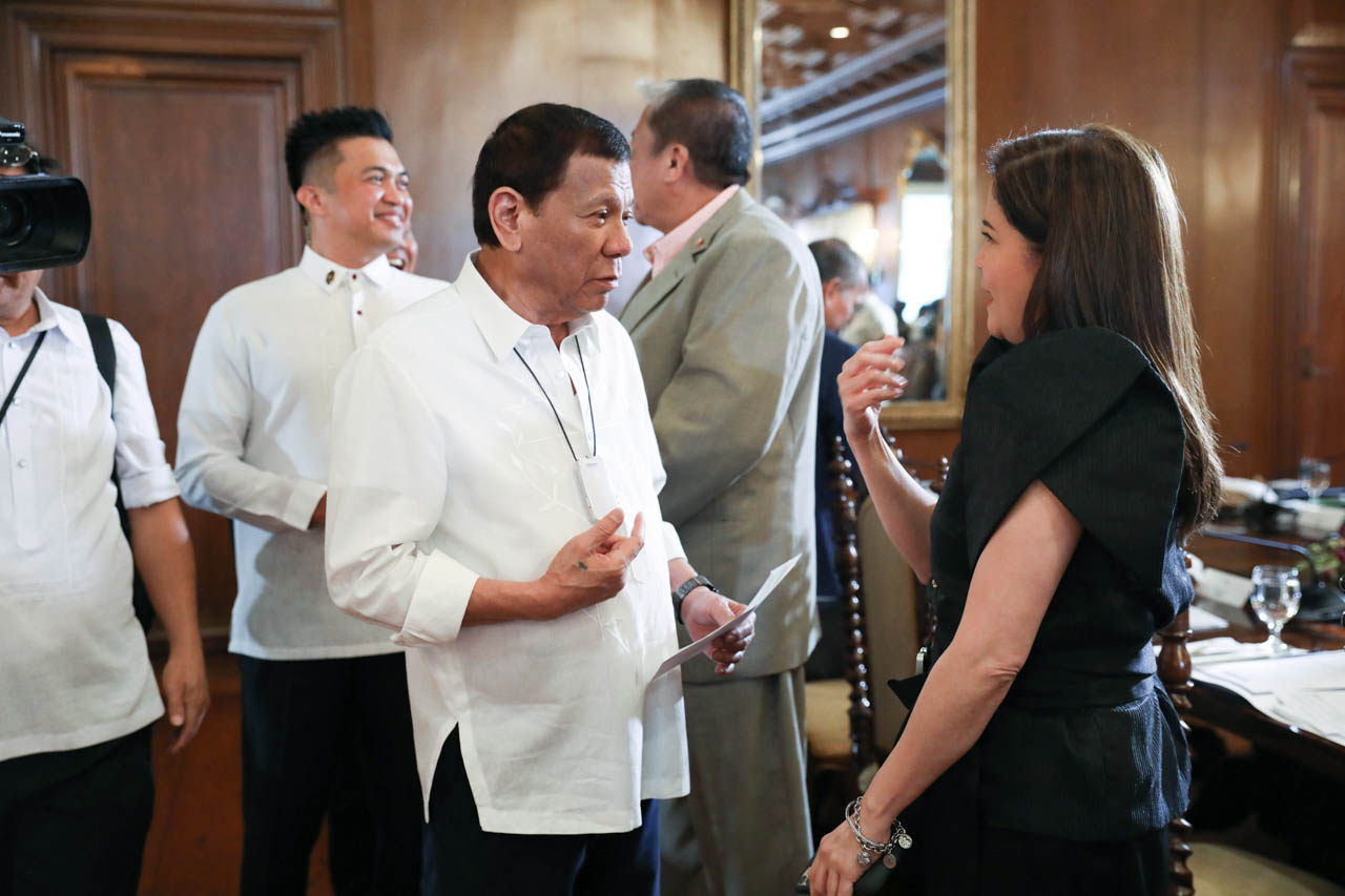ANOTHER JOKE? President Rodrigo Duterte chats with Tourism Secretary Bernadette Puyat prior to the start of the 46th Cabinet meeting at Malacau00f1ang Palace on March 2, 2020. Malacau00f1ang file photo